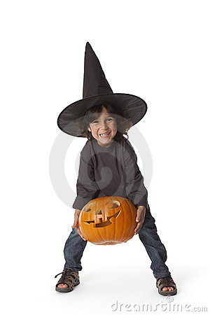 Little boy is lifting a Halloween pumpkin