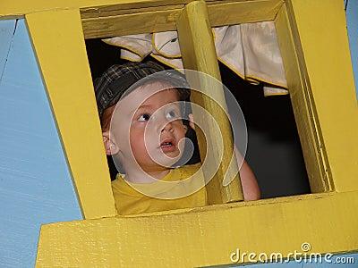 Little boy lookinf out window 48