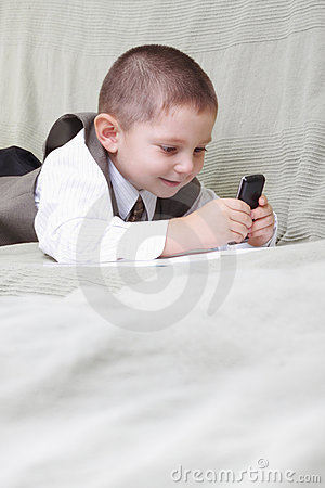 Little boy looking at cellphone