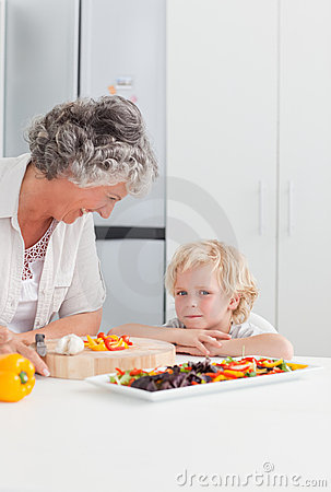 Little boy looking at his grandmother