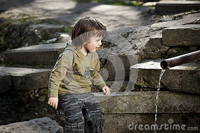 Little boy looking  at spring