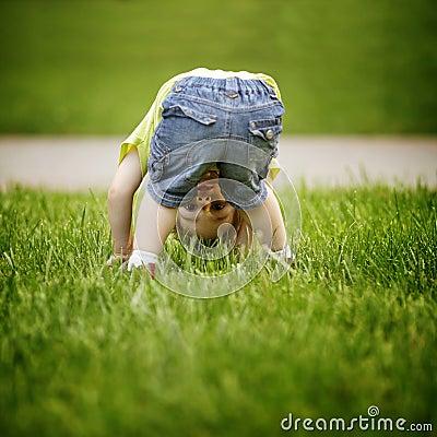The little boy looks upside down