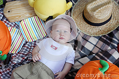 Little boy lying on his back, picnic