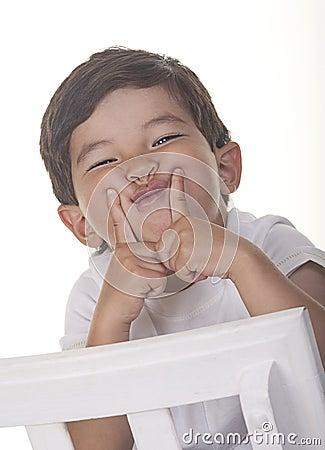 Little boy makes a funny face.