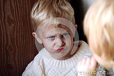 Little boy making pouting