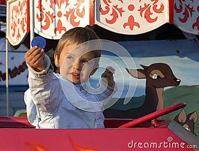 Little boy on a merry-go-round