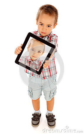 Little boy photographing himself