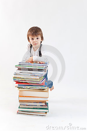 Little boy with a pile of books