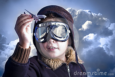 Little boy in the pilot`s hat