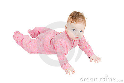 Little boy in ping pyjamas creeping on the floor