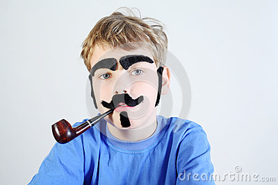 Little boy with pipeful, fake mustache, eyebrows, beard