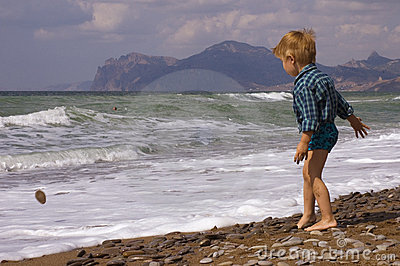 Little boy play on the beach