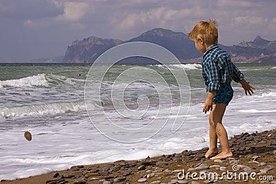 Little boy play on the beach