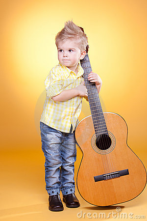 Little boy play the guitar
