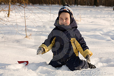 Little boy play with snow