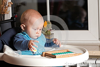 Little boy playing with abacus indoor