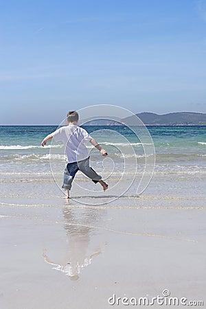 Little boy playing on a beach