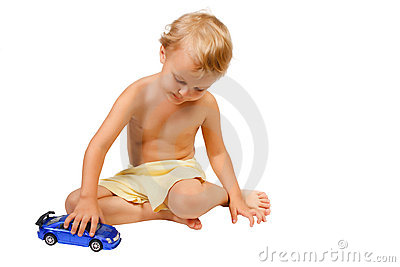Little boy playing with blue toy car