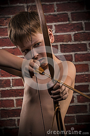 Little boy playing with bow and arrow
