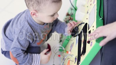 Little Baby Boy Intently Playing With Busy Board Stock ...