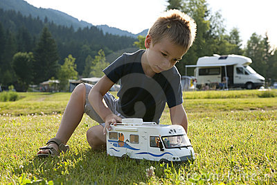 Little boy playing at camping site