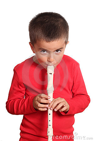 Little boy playing the flute