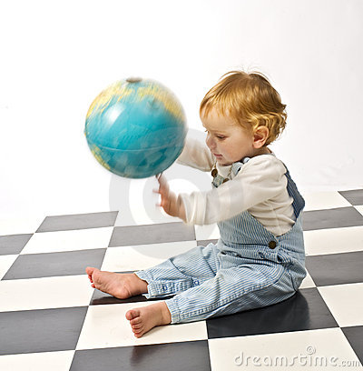 Little boy playing with a globe