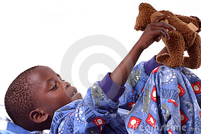 Little boy playing with his teddy bear