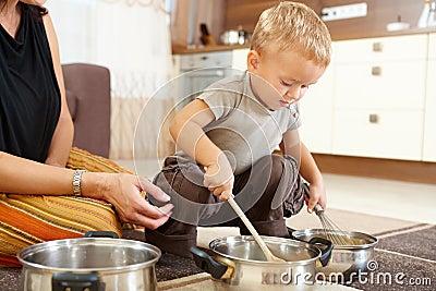 Little boy playing in kitchen