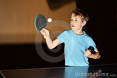 Little boy playing ping pong