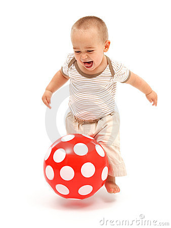 Little boy playing with red ball