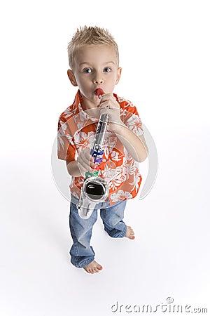 Little boy playing saxophone