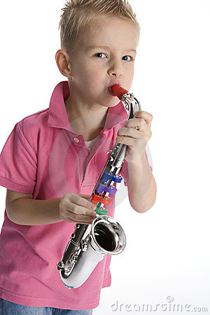 Little boy playing toy saxophone