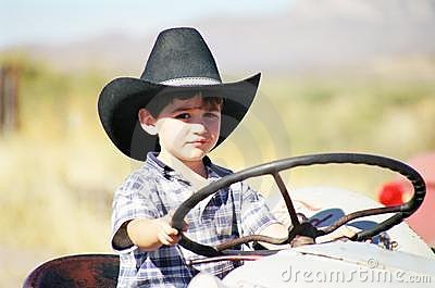 Little boy Playing on Tractor