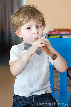 little boy playing wooden flute indoor royalty free stock