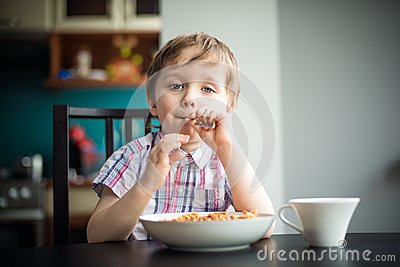 The little boy plays with a fork
