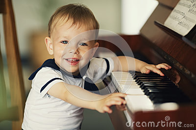 Little boy plays piano