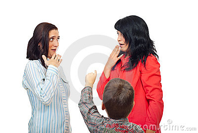 Little boy pointing to two women
