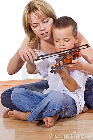 Little boy practicing the violin