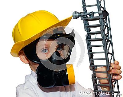 Little boy - preschooler in fireman face mask
