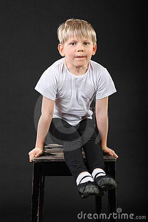 Little boy pull on hands at old stool
