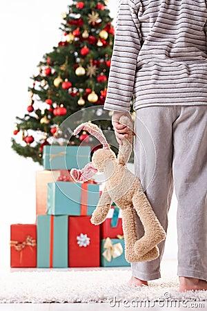Little boy in pyjama on christmas morning