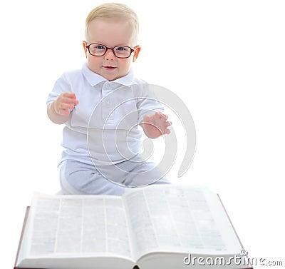 Little boy reads a big book
