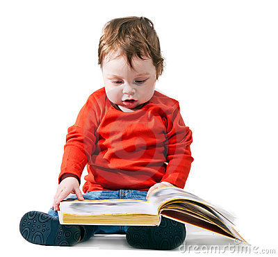 Little boy reads the book interestedly