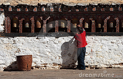 Little boy revolving the prayer wheels Editorial Stock Photo