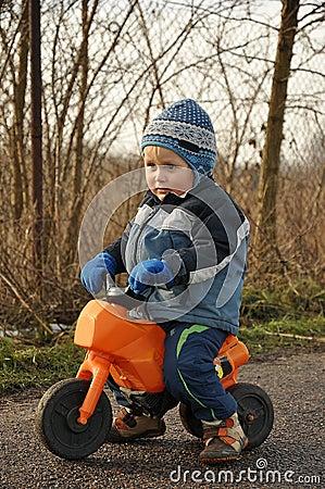 Little boy riding motorbike