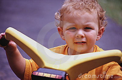 Little boy on riding toy