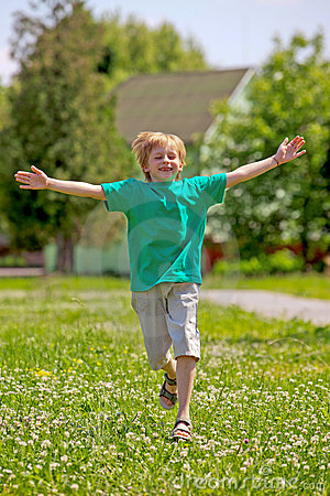 Little boy running in park