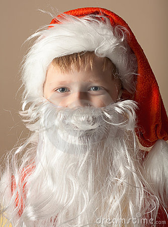 Little boy in Santa Claus suit with beard