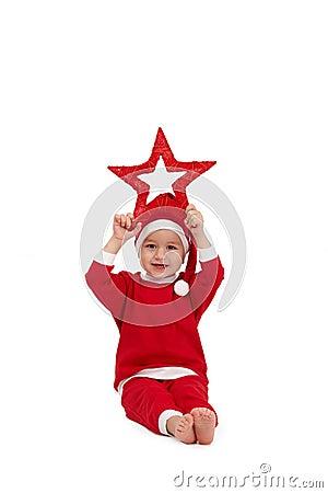 Little boy in santa wear with star
